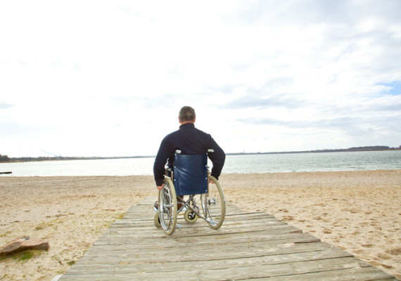 wheelchair man on beach
